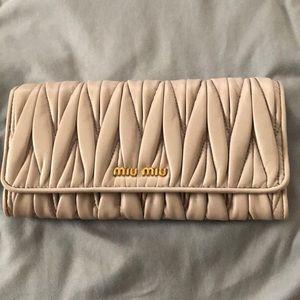 New! Miu Miu matelasse wallet taupe color